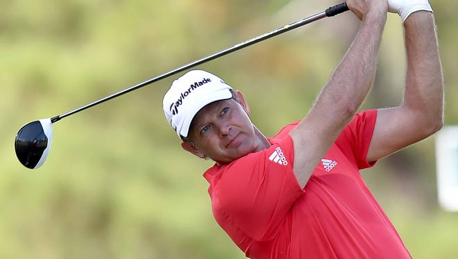 Retief Goosen watches his tee shot on number two on Thursday, October 27, 2016, the first day of tournament play in the Sanderson Farms Championship at the Country Club of Jackson in Jackson, Miss.