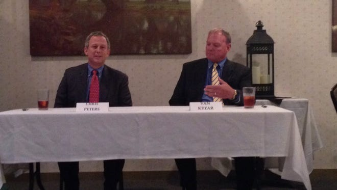 Chris Peters (left) and Van Kyzar talk about the 3rd Circuit Court of Appeal race at an October forum in Alexandria.