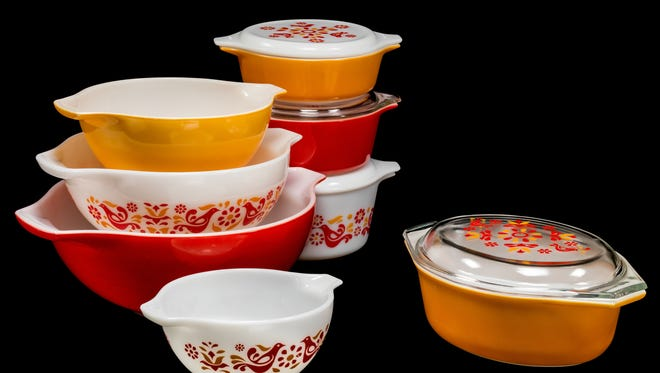 "Pyrex mixing bowls and casserole dishes in ""friendship"" pattern. The Corning Museum of Glass offered a special exhibit to celebrate the 100th anniversary of the Pyrex brand."