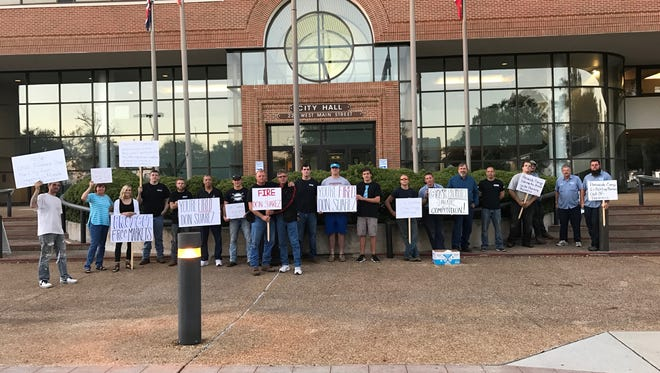 About 20 plumbers turnoed out to the Pensacola City Council meeting Thursday to oppose a plan by Pensacola Energy to begin offering installations.