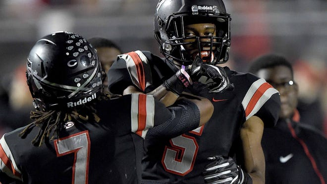 Clinton's Kam'ron White (5) celebrates an Arrows touchdown with Darius Maberry (7) on Friday, November 25, 2016, in the MHSAA Class 6A North State Championship at Clinton High School in Clinton, Miss.