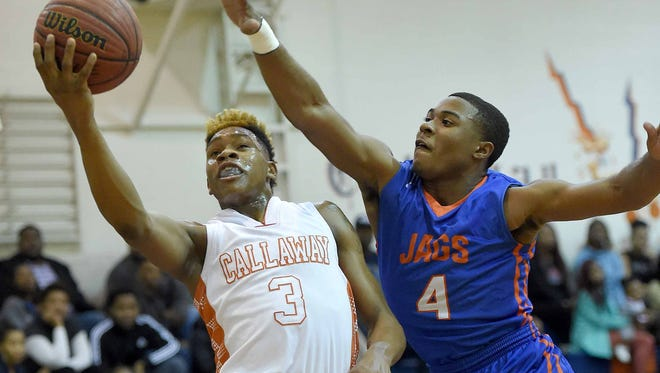 Callaway's John Knight goes for a layup against Madison Central's Javion Jordan during Friday's 88-65 win.