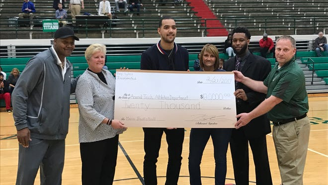 Former Tech star and 2014 IndyStar Trey Lyles (center) donates $20,000 to the school.
