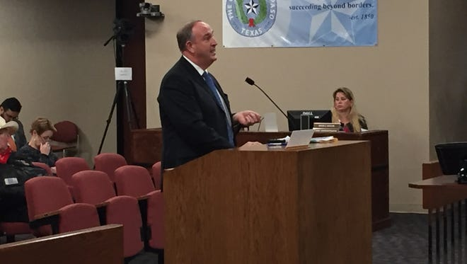 William R. Cox, the El Paso County Public Defender's Office first assistant, provides a caseloads presentation Monday.