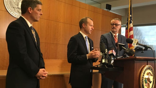 From left to right, Federal prosecutors Geoffrey Barrow, Ethan Knight, and U.S. Attorney for Oregon Billy Williams speak at a news conference in Portland, Ore., March 10, 2017, following the conviction of two men of conspiracy to impede federal officers during last year's high-profile armed occupation of an Oregon wildlife refuge.
