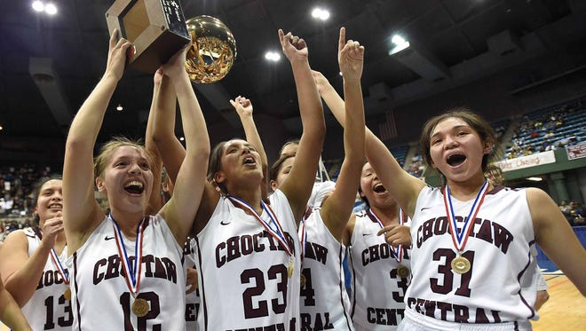 The Choctaw Central Lady Warriors celebrate with the Class 3A trophy after beating Amanda Elzy 75-42 on Saturday in a girls' basketball state championship game in Mississippi Coliseum.