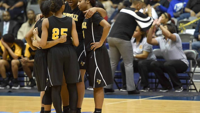 The Starkville Lady Jackets huddle before the game with Olive Branch as head coach Kristie Williams high fives her staff in the background on Saturday, March 11, 2017, in the MHSAA C Spire State Basketball Championships at the Mississippi Coliseum in Jackson, Miss.