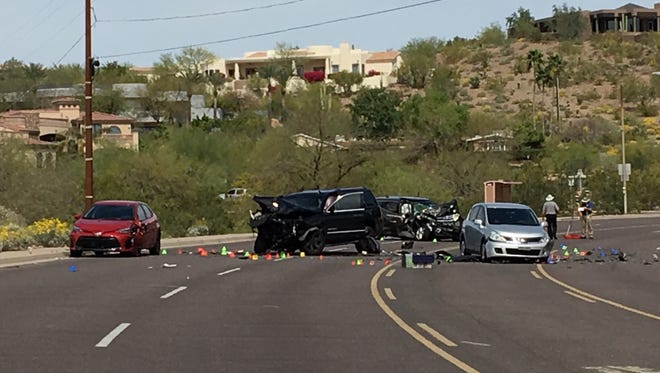 Police say the driver of a large SUV crossed a median on 44th street near Camelback Road and crashed head-on with a smaller SUV on March 15, 2017. Two people were injured, one critically.