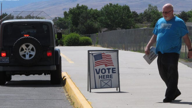 A man leaves a primary voting station in Sparks last year.