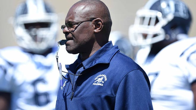 Head coach Tony Hughes runs pregame drills on Saturday, April 8, 2017, in the Jackson State University Blue and White Spring Game at Mississippi Veterans Memorial Stadium in Jackson, Miss.