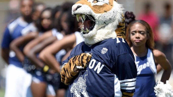 The JSU Tiger mascot and cheerleaders honor the flag during the National Anthem on Saturday, April 8, 2017, in the Jackson State University Blue and White Spring Game at Mississippi Veterans Memorial Stadium in Jackson, Miss.