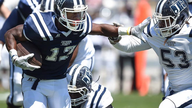 Jordan Johnson (17) stiff arms Dres Whitlock (53) on Saturday, April 8, 2017, in the Jackson State University Blue and White Spring Game at Mississippi Veterans Memorial Stadium in Jackson, Miss.