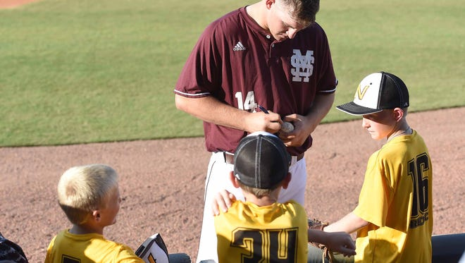 MIssissippi State's Riley Self (14) signs autographs for young fans before the game on Tuesday, April 25, 2017, in Governor's Cup, the final game of the 2017 Mississippi College Series, at Trustmark Park in Pearl, Miss.