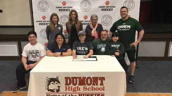Jasmine Vera will play softball next year at Drew University. Sitting, from left: Vera's brother, Juan; her mother, Mariquitaliza; Jasmine Vera; her father, Juan; and sister, Victoria. Standing, from left: Coach Kendal George, guidance counselor Jackie Bello, Vera's grandmother, and batting coach Rob Debrino,