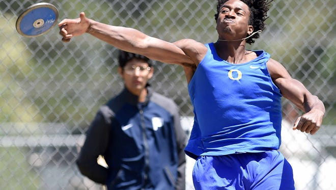 Oxford's D.Q. Thomas throws the discus on Friday, May 5, 2017, in the MHSAA Class 1A-3A-5A State Track Meet at Pearl High School in Pearl, Miss.