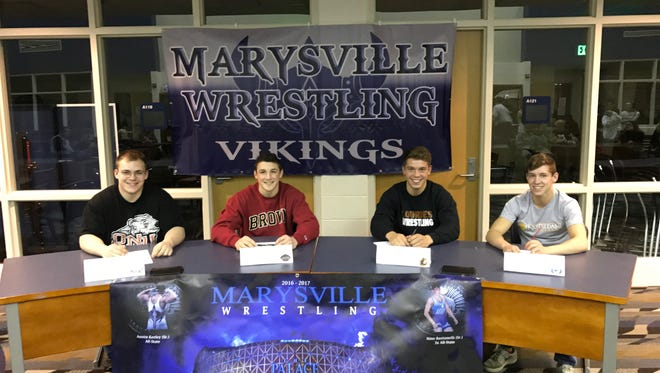 Marysville High School seniors Ausitn Keeley, Nino Bastianelli, Tyler Gates and Kyle French all signed to wrestle in college.