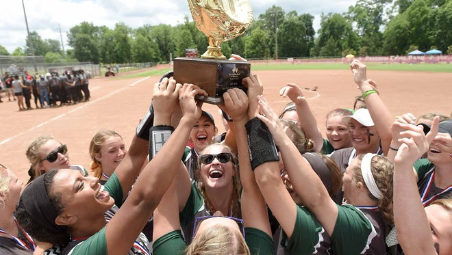 The Mooreville Lady Troopers celebrate with the Class 3A trophy after beating Choctaw Central 7-0 on Friday, May 12, 2017, in the MHSAA Fast-Pitch Softball State Championship at Freedom Ridge Park in Ridgeland, Miss.