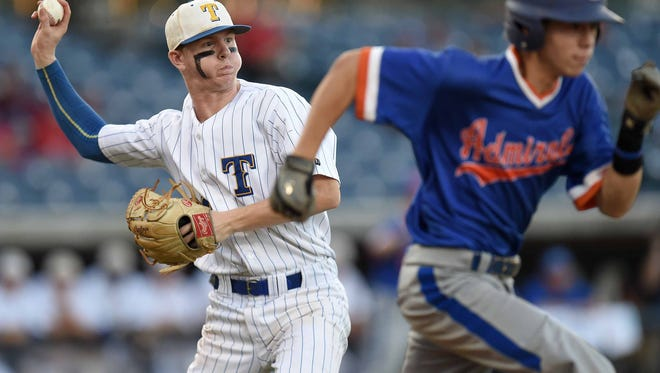 Tupelo pitcher Jakson Bridges (left) throws out Gulfport's Carlton White (right) on Wednesday, May 17, 2017, in the MHSAA State Baseball Championships at Trustmark Park in Pearl, Miss.