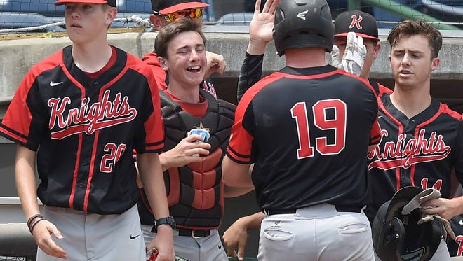 West Lauderdale's Jake Mason gets congratulations for scoring against Corinth on Thursday, May 18, 2017, in the MHSAA State Baseball Championships at Trustmark Park in Pearl, Miss.