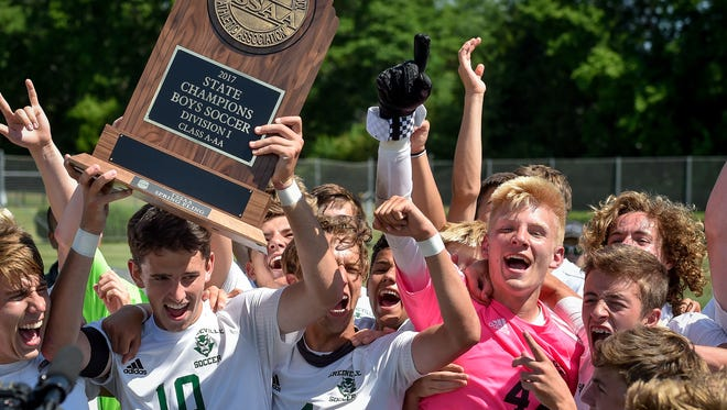 Greeneville players including Gray Hull (10) celebrate after their Class A-AA championship victory against Page at the Richard Siegel Soccer Complex in Murfreesboro, Tenn., Friday, May 26, 2017.