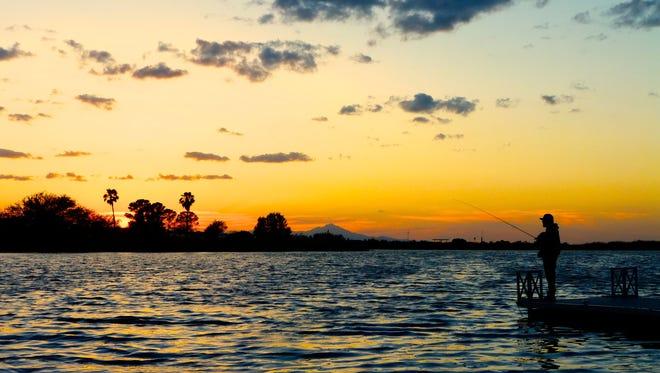 An angler enjoys a tranquil sunset at Roper Lake State Park.
