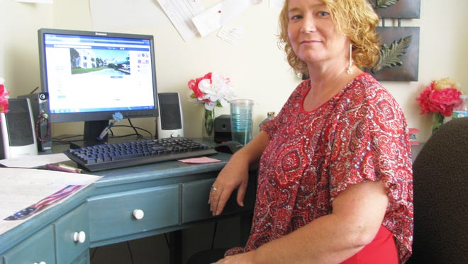 Rachel Dorminey, enrichment coordinator at The Isles of Vero, reviews the posting of resident activities on Facebook.