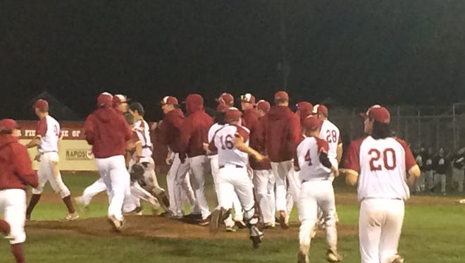 The Rafters celebrate following their 6-4 comeback win over the Chinooks in a playoff opener on Monday.