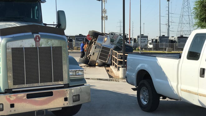A man was extracted from an overturned semitruck on Aug. 30, 2017, in Surprise.