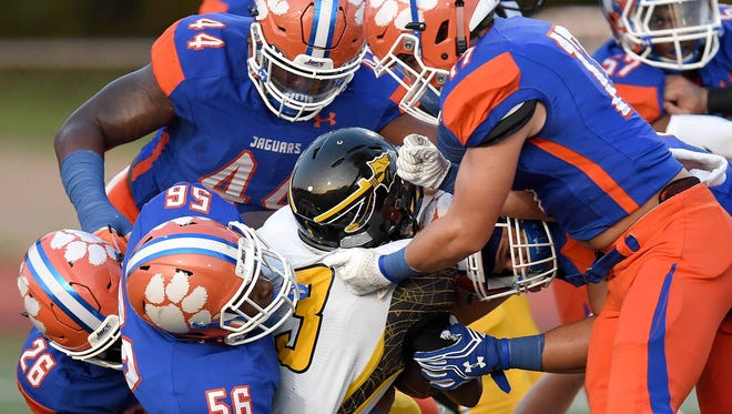 D'Iberville's Ja'quavis Foster is gang tackled by the Madison Central defense on Friday, September 1, 2017, at Madison Central High School in Madison, Miss.