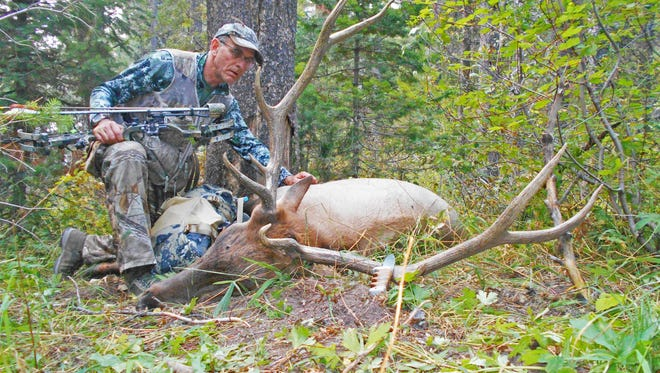 Patrick Durkin with a bull elk he arrowed on Labor Day in southeastern Idaho.
