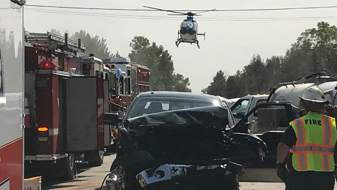 A helicopter lands on Wadhams Road to transport a seriously injured car accident victim to the hospital.