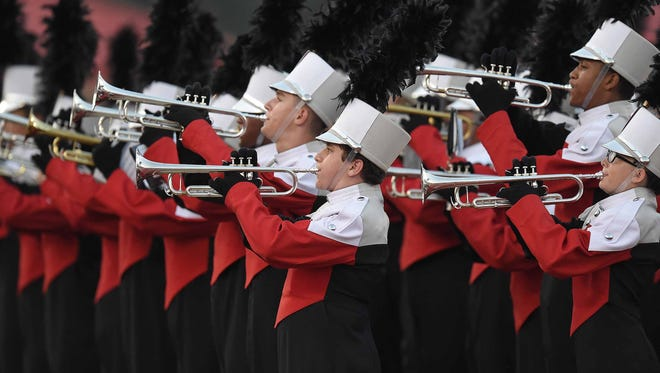 The Clinton band plays to the home stands before the game on Friday, September 22, 2017, at Clinton High School in Clinton, Miss.