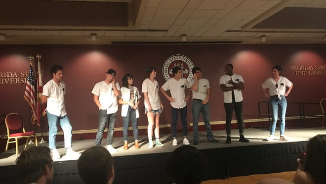 Members of No Bears Allowed perform in front of a large crowd in the Union Ballrooms.