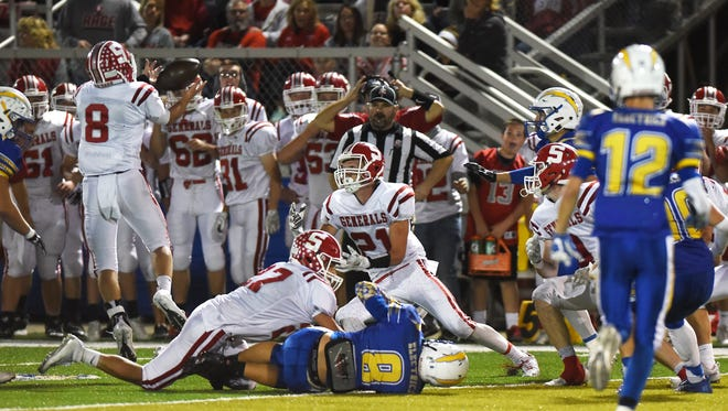 Sheridan's Grey Bennett recovers an onside kick late against Philo. Sheridan couldn't capitalize in a 21-18 loss.