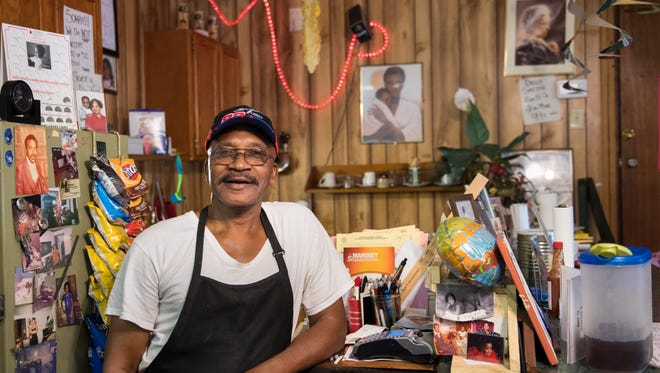 Mac's BBQ Owner James Morrow, of Bolivar,  poses for a portrait Wednesday, October 4, 2017, at the cash register of Mac's BBQ at 630 Hollywood Drive in Jackson. Party streamers, starry lights, family pictures and balloons adorn the walls of his downtown restaurant. Morrow has been cooking barbecue for 46 years.
