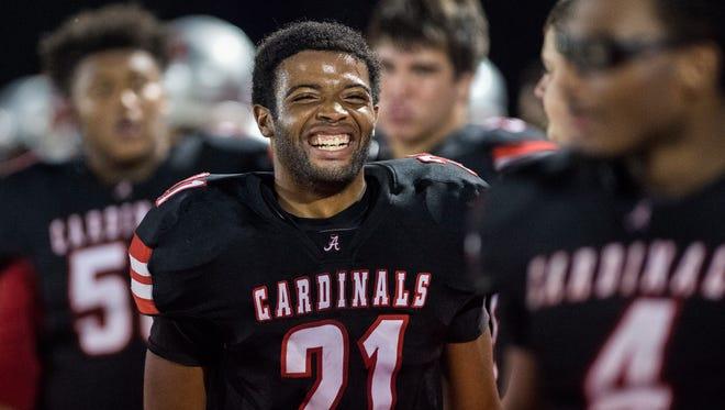 Adamsville's Rhomerius Knight laughs from the sideline Friday, October 6, 2017, during Adamsville's 42-6 victory over McKenzie at Adamsville High School.