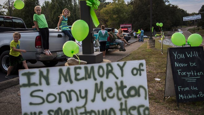 Wearing green, friends and family gather at Big Sandy Elementary School off Highway 69A to welcome home Heather, James and Susan Melton on Saturday, October 7, 2017, in Big Sandy.