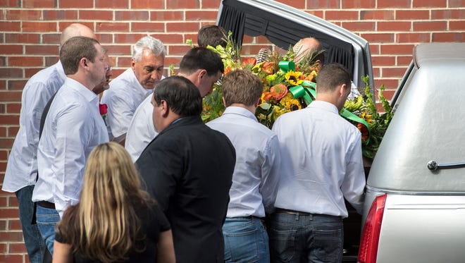 Heather Melton looks on as pallbearers load Sonny Melton's casket into the hearse Tuesday, October 10, 2017, after his funeral at Big Sandy High School.