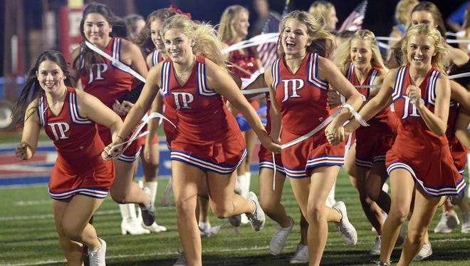 The Prep cheerleaeers lead the Patriots onto the field on Friday, October 13, 2017, at Jackson Prep in Flowood, Miss.