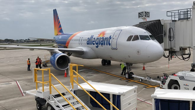 An Allegiant jet is parked at a gate Friday at Milwaukee's Mitchell International Airport.