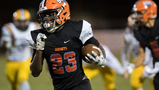South Gibson's Dre McAllister runs with the ball Friday, October 13, 2017, during Covington's 48-21 victory over South Gibson at South Gibson County High School.