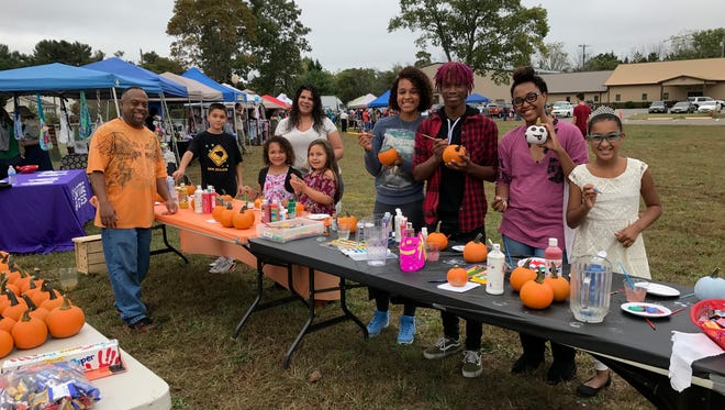 Pumpkin painting was among the fun activities held as part of the Cumberland County Community Church's Fall Family Festival and Millville Chiropractic Center's Community Health Fair.