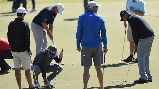 PGA Tour players work on their putting before practice rounds on Tuesday at the Sanderson Farms Championship at the Country Club of Jackson.