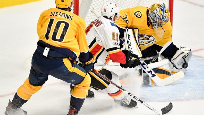 Nashville Predators goalie Pekka Rinne (35) defends against Calgary Flames center Mikael Backlund (11) during the third period at Bridgestone Arena in Nashville, Tenn., Tuesday, Oct. 24, 2017.