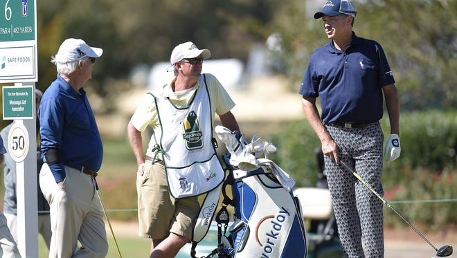 Davis Love III chats with his playing partners on the 6th tee during the Allen Exploration Pro-Am on Wednesday, October 25, 2017, at the Sanderson Farms Championship at the Country Club of Jackson in Jackson, Miss.
