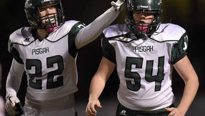 Pisgah's Bryce Lofton (22) and Garrett Price (54) celebrate a Dragons touchdown on Friday, October 27, 2017, at St. Joseph Catholic School in Madison, Miss.