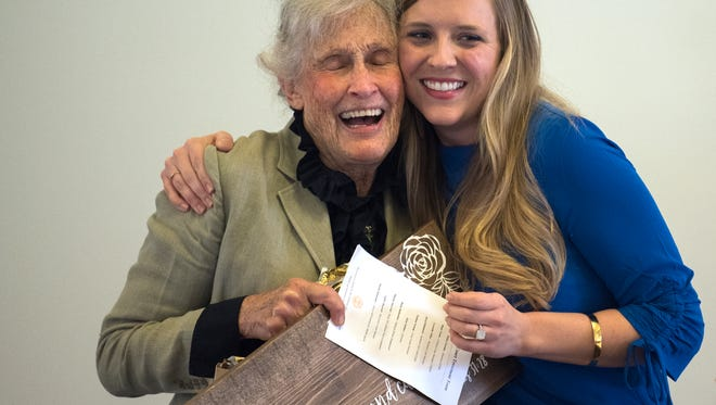 """Recovery court director Haley Geeslin embraces Cornelia """"Ms. Happy"""" Tiller on Wednesday, Nov. 1, 2017, during the City of Jackson Recovery Court's Appreciation Luncheon at the New Southern Hotel in Jackson."""