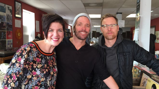 Nebraska native Dana Chamberlain poses for a photo with Taylor Hawkins and Nate Mendel from the Foo Fighters.