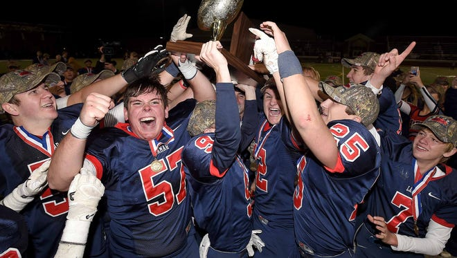 The Lamar School Raiders celebrate with the trophy after beating Simpson Academy 33-32 in overtime on Saturday, November 17, 2017, in the MAIS Class AAAA, Division II Football State Championship at Jackson Academy in Jackson, Miss.