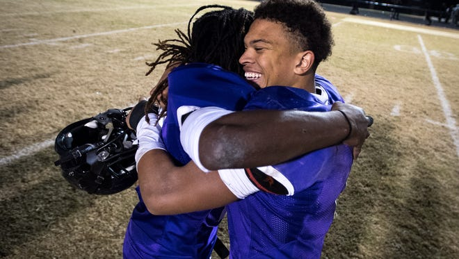 Cane Ridge's Rishone Burleson (17, left) and Jahsun Bryant (11, right) hug after their Class 6A semifinal victory over Whitehaven at Cane Ridge High School in Antioch, Tenn., Friday, Nov. 24, 2017.